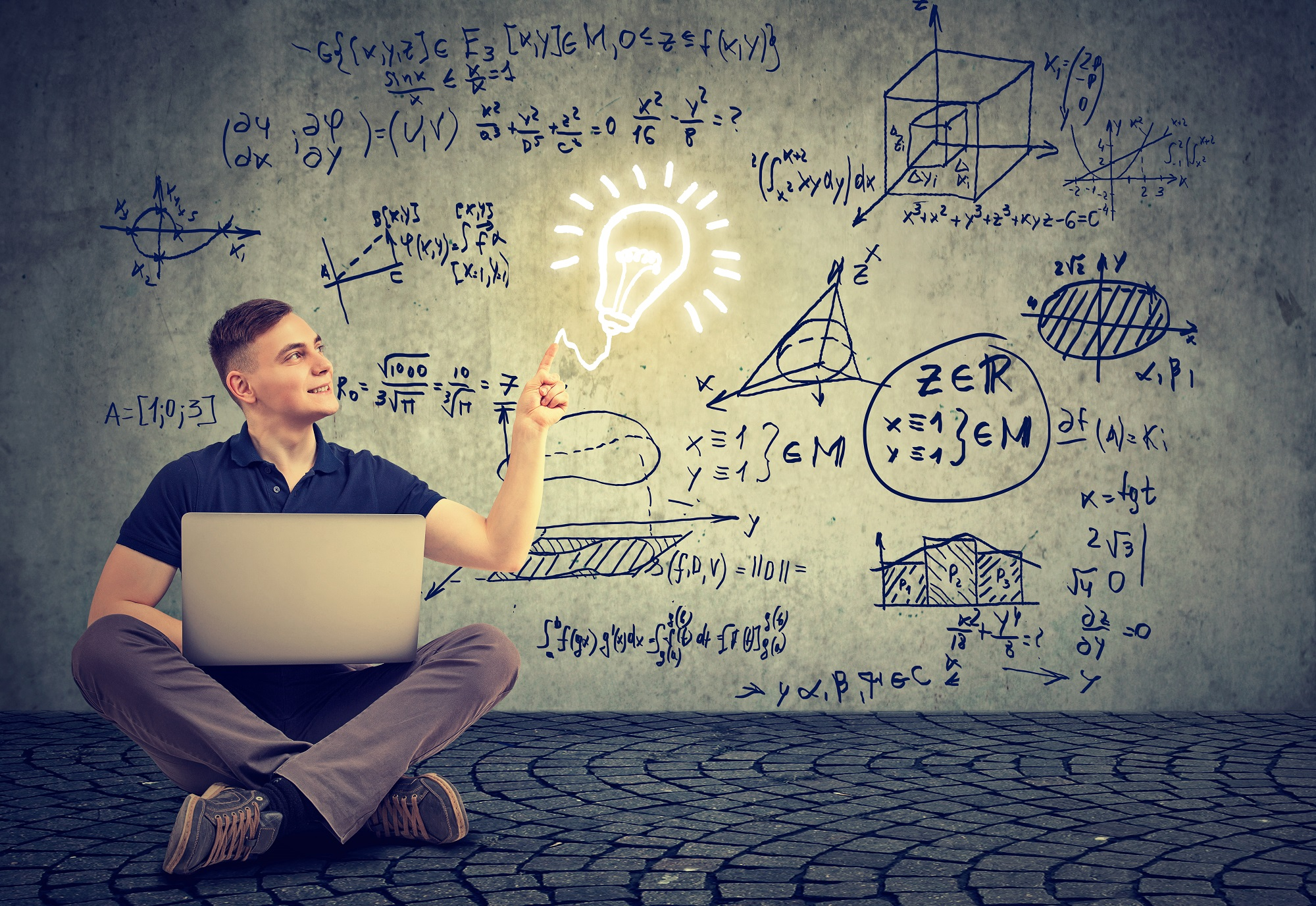 Man Using Laptop Computer On A Background With Science Formulas