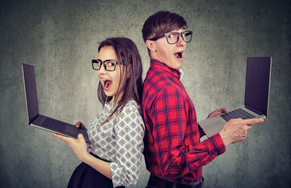 Surprised Funny Looking Man And Woman With New Laptops